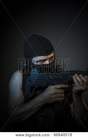 Bandit, Man wearing balaclavas and bulletproof vest with firearms