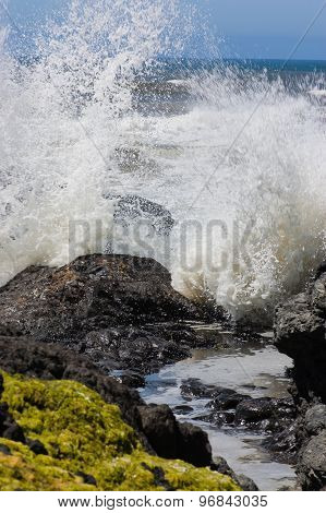 Waves crashing against a rocky shore