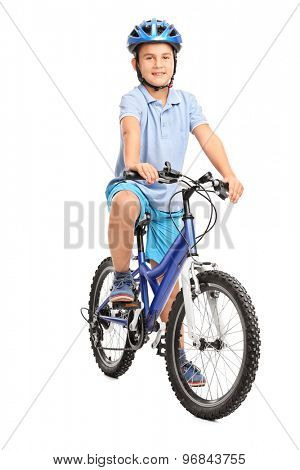 Full length portrait of a little boy with blue helmet sitting on his bicycle and looking at the camera  isolated on white background