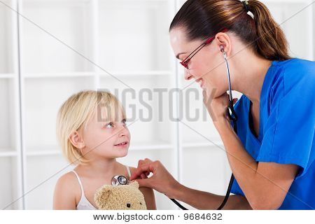 little girl having checkup