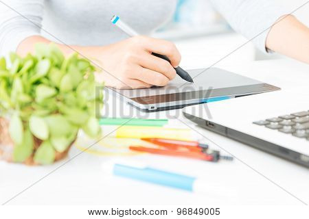 Close Up Designer Using Graphic Tablet Design On Desk