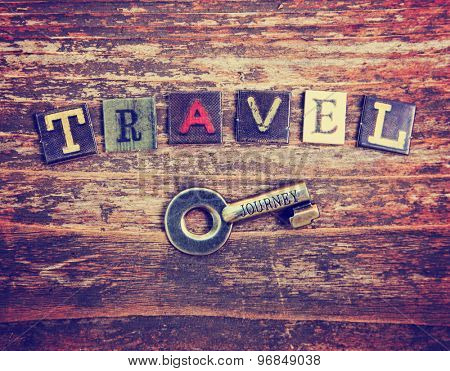 an old vintage background with the word travel over  a key that has the same word etched in it toned with a retro vintage instagram filter effect app or action