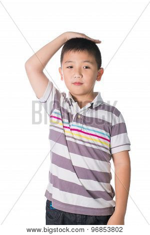 Boy Growing Tall And Measuring Himself, Isolated On White Background