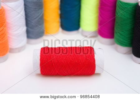 Colorful Bobbins  On A White Background
