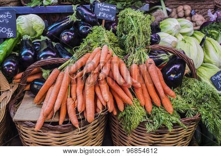 Carrot and eggplant on market stall