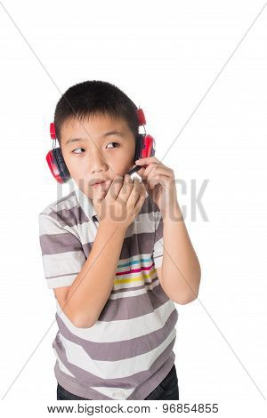 Asian Boy Listening Music With Headphones, Isolated On White Background