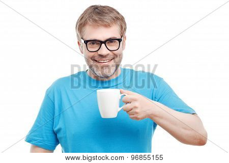 Cheerful man drinking tea