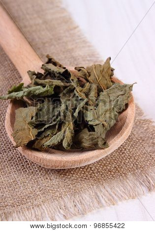 Heap Of Dried Lemon Balm With Spoon On White Wooden Table, Herbalism