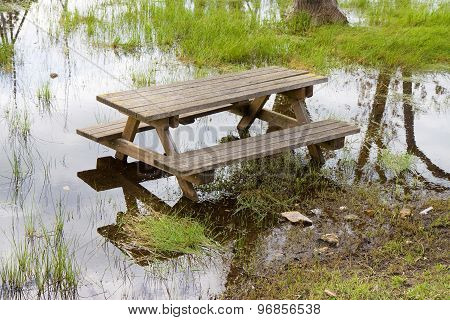 Picnic Table Isolated In A Flooded Campground