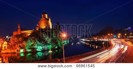 Illuminated Metekhi Church at night in Tbilisi, Georgia