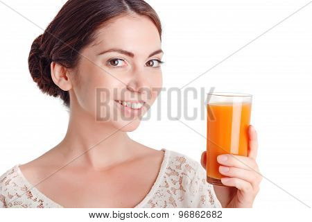 Pretty young girl drinking juice