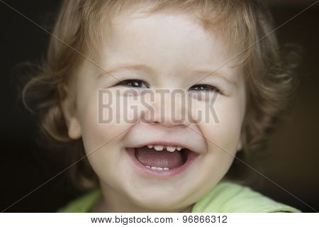 Portrait Of Laughing Child