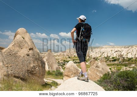 Lonely traveler looking to Cappadocia rocks