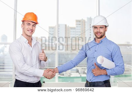 Successful young builders are congratulating each other