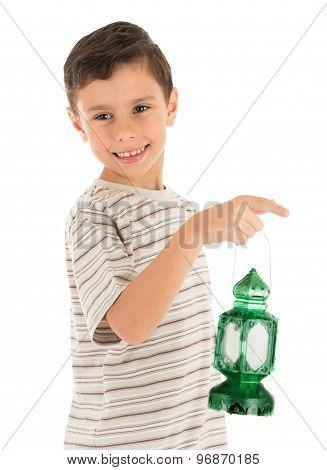 Muslim young boy feeling happy with Ramadan Lantern