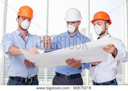 Attractive young builders are working on a new project