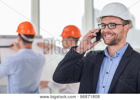 Young attractive engineer is communicating with his client