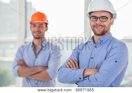 Cheerful young builders are working on a project