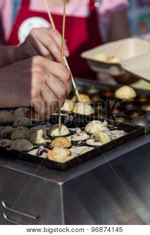 Cooking Hot Takoyaki Balls In Street Food