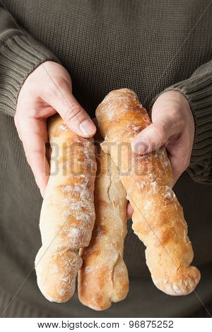 Holding Baguettes