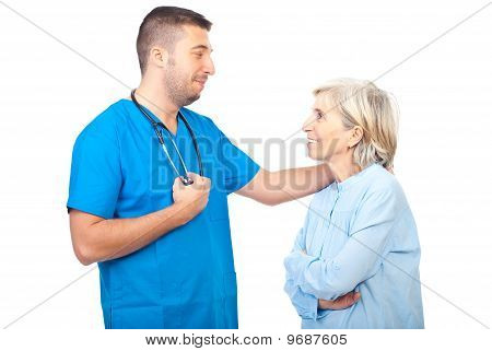 Doctor Male Converse With Senior Patient