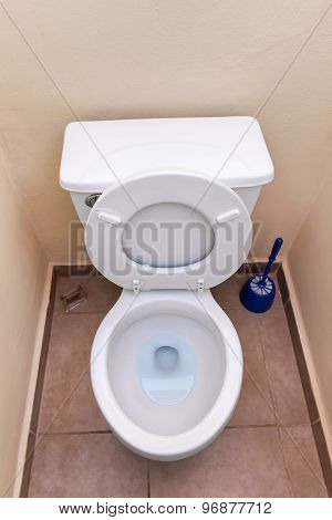 White Toilet Bowl And Toilet Paper