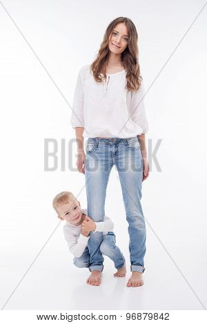 Pretty young woman is playing with her kid
