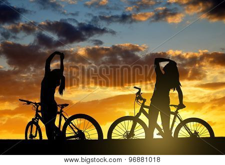 Girls on a bicycle in the sunset