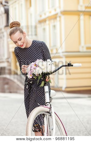 Attractive young woman is cycling in town