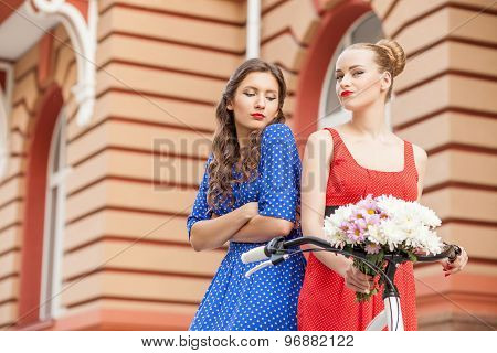 Beautiful young women are walking across city