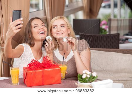 Attractive young women are resting in cafe