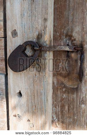 Iron Lock On An Old Wooden Door