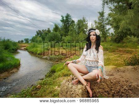 Boho Girl Contemplates On Bank Of River.
