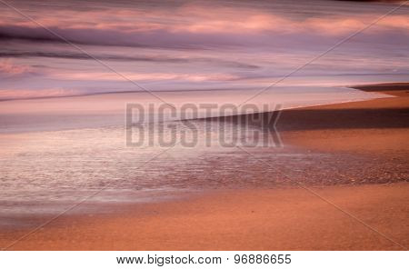 Abstract sunset with beach and waves