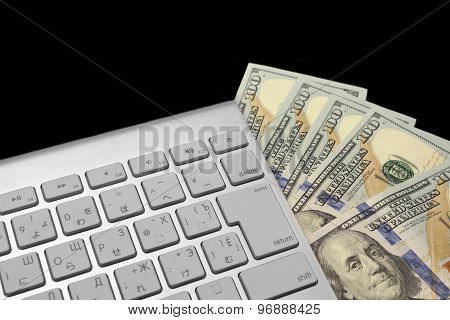 American Dollars Bills And Wireless Keyboard Isolated On Black