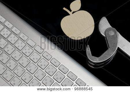 Wireless Keyboard, Wooden  Apple Slice And Wrench Isolated On Black