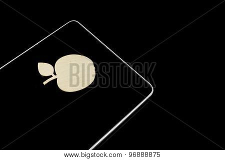 Wooden Apple Slice On Lcd Tablet Display Isolated On Black