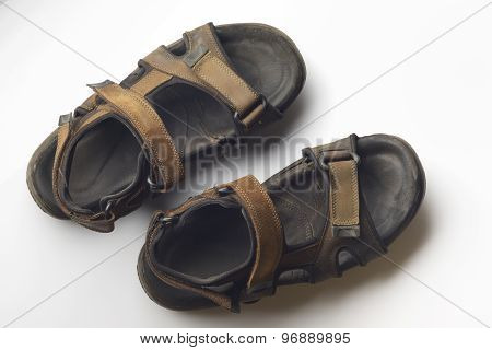 Brown suede leather sandals on white background.