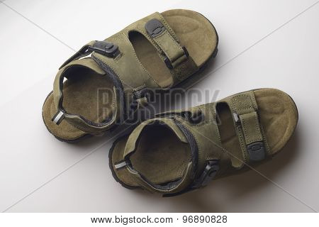 Green Leather Sandals on White Background