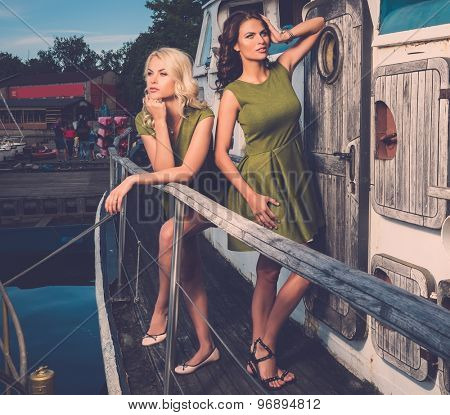 Stylish women on old rusty boat