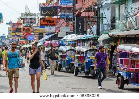 Tourists Walk Along Backpacker Haven Khao San Road And Tuktuk Aro