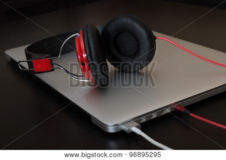 Charging Notebook With Connected Red Headphones