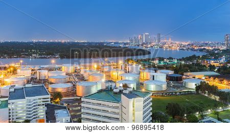 Oil storage tank along with river