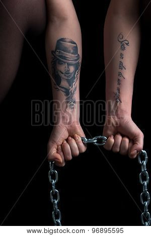 Photo of woman's hands holding chain