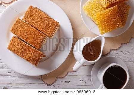Honey Cake Close-up, Coffee, And A Honeycomb. Horizontal Top View