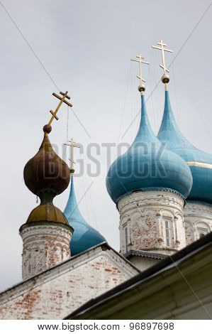 falling cross old Orthodox Church against the new domes