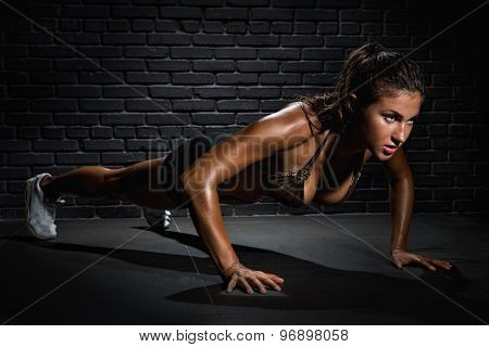 Young woman pushing up on floor