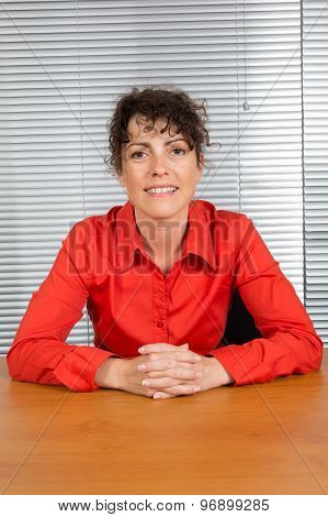 Office Woman In Red Shirt At Her Desk