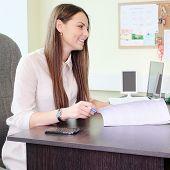foto of secretary  - secretary comunicates with visitor - JPG