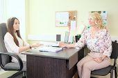 picture of secretary  - secretary comunicates with visitor - JPG